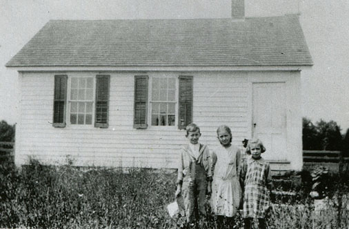images of the one-room schoolhouse, in 2020 and in 1918.
